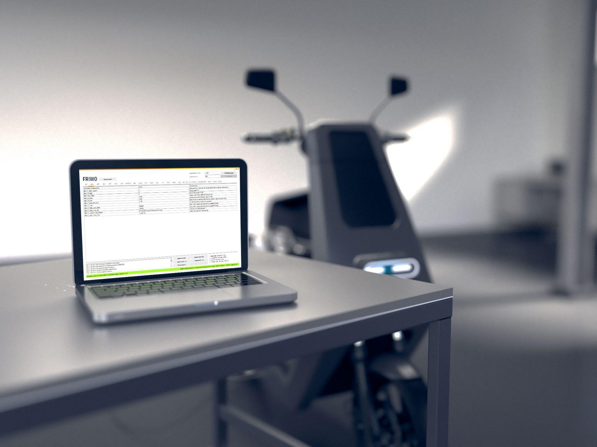Laptop mit Emerge Software und Elektroroller